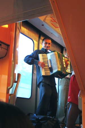 Busker on our RER train to Disney Paris